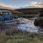 Land Rover fording a river