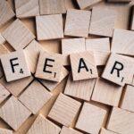 The word fear spelt out in scrabble blocks
