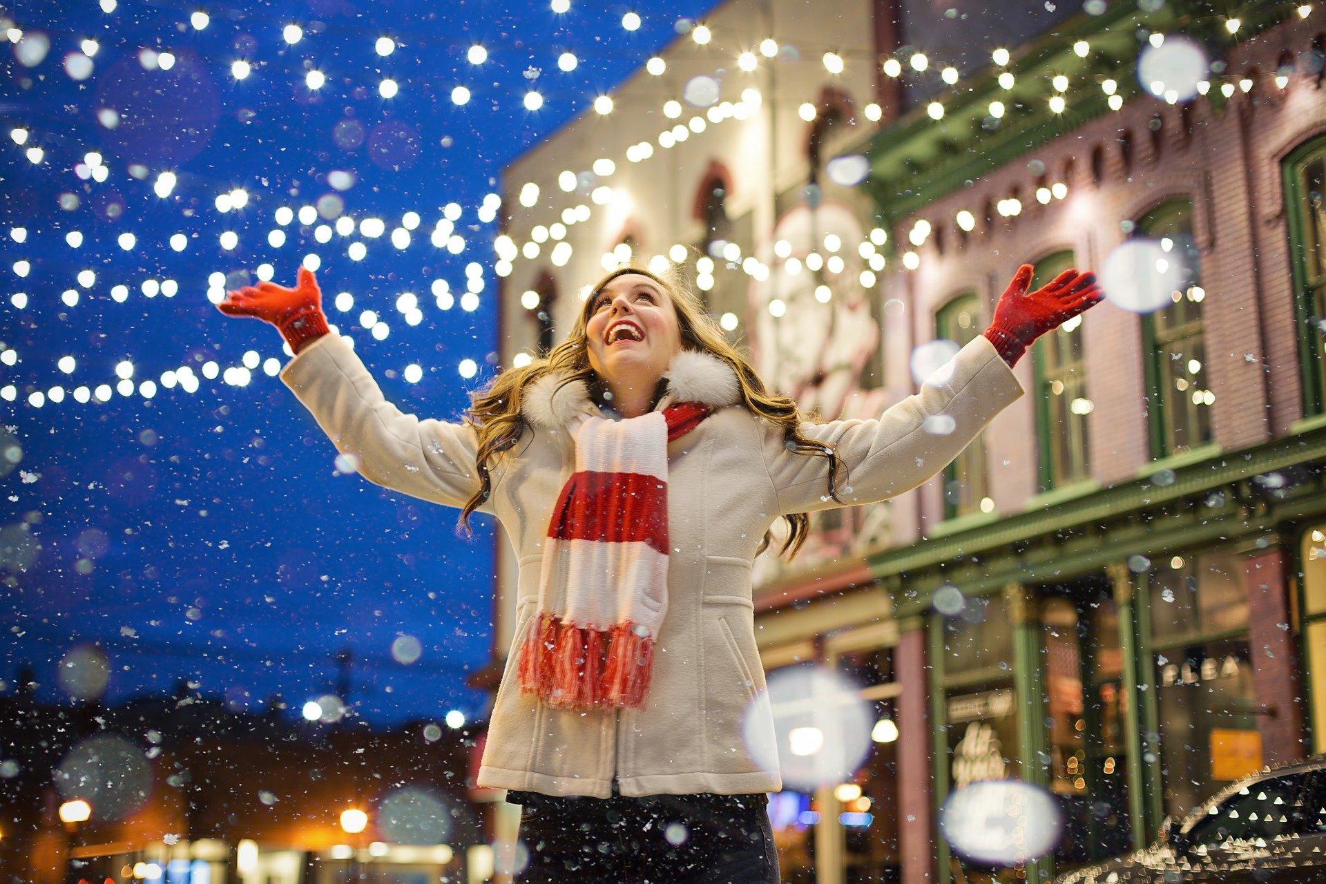 Woman staring at Christmas lights