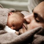 father and child asleep