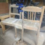 Two old chairs being converted to a love seat