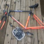 The dismantled bike with components