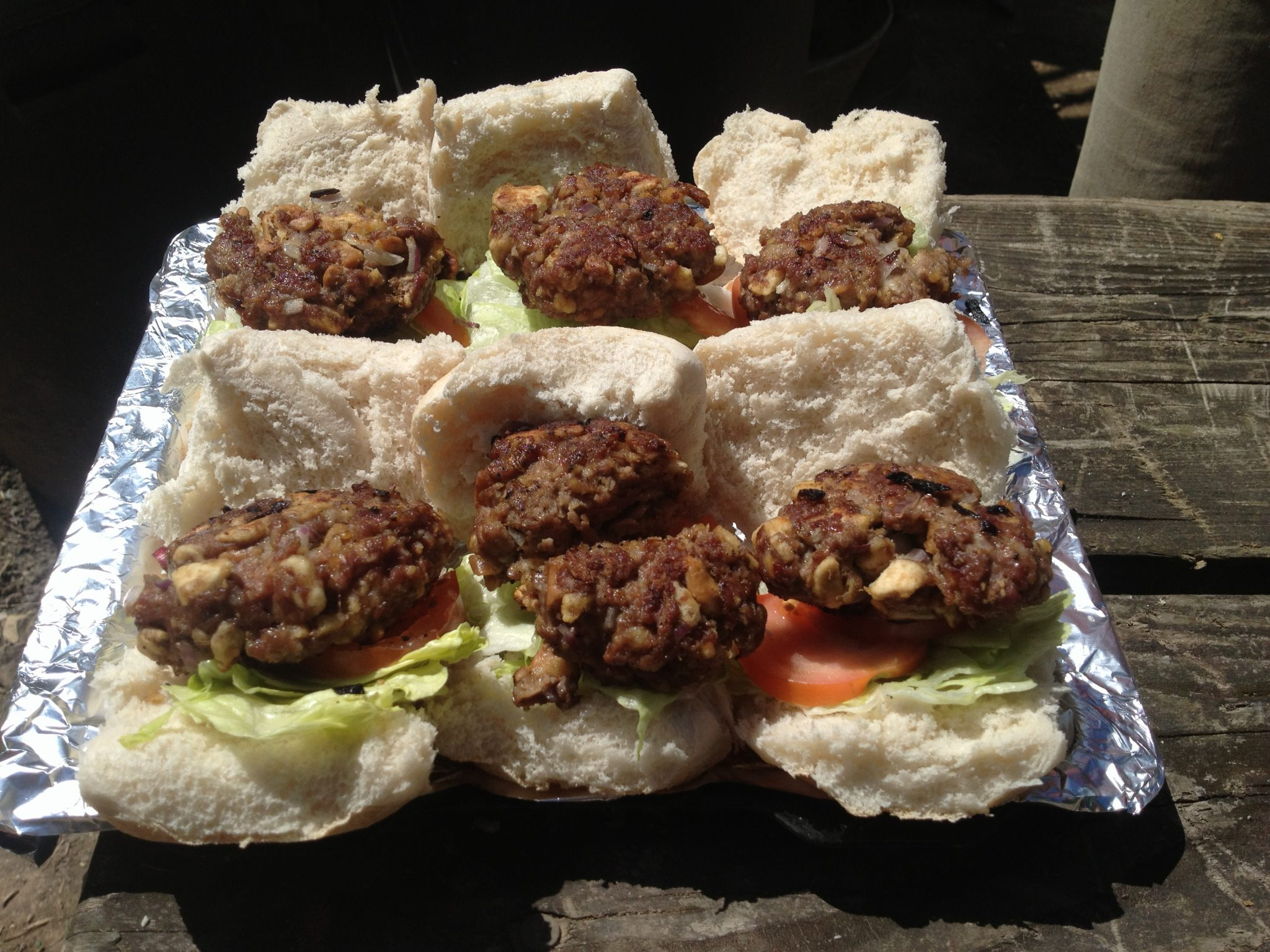 Burgers cooked and made entirely on our woodland site using an outdoor kitchen